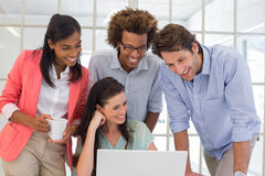 Coworkers working together and smiling Stock Photo
