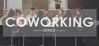 Coworking concept. Business people working in office stock image