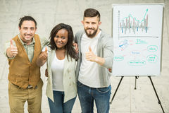 Coworking. Creative team looking at camera and making thumbs up. Team work concept royalty free stock photos
