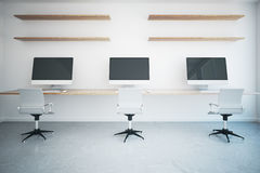 Coworking office with blank monitors Stock Photo