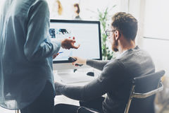 Coworking process,managers team work new project.Photo young business crew working with startup modern office.Desktop royalty free stock photo