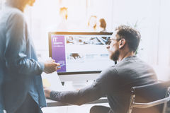 Coworking process photo.Managers team work new project.Young business crew working with startup modern office.Desktop royalty free stock photo