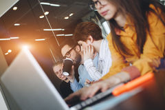 Coworking team brainstorming in modern office. Working atmosphere in meeting room. Young creative managers team working with new s. Tartup project in modern royalty free stock images