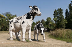 Cows. The sculptures of cows on the grassland Royalty Free Stock Photo