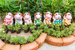 Cows ceramic for decoration in garden, Happy dolls in the garden Royalty Free Stock Photo