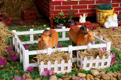 Free Cows Ceramic Toy In A Farm With Seraph And Cupid Background Royalty Free Stock Image - 90779746