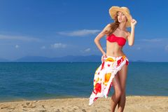 Coy blonde beauty in a red bikini Stock Images