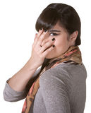 Coy Hispanic Female. Hiding part of face with hand royalty free stock photography