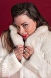 Coy Pinup Girl en abrigo de pieles Fotos de archivo