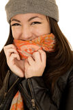 Coy teen model wearing a winter beanie and scarf. Coy teen model wearing a beanie and scarf covering her smiling mouth Stock Images