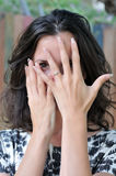 Coy woman with engagement ring Stock Images