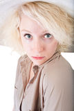 Coy Young Person. One coy blond female on white background royalty free stock photography