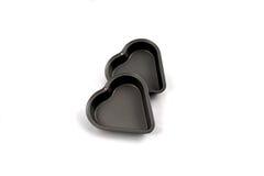 Cozendo dois estanhos tart do coração, a cozinha relacionou-se fotografia de stock royalty free
