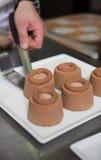 Cozendo e cozinhando o chocolate e desertos doces Imagens de Stock Royalty Free