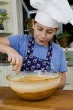 Cozendo uma torta 4 Fotos de Stock Royalty Free
