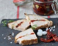 Cozido com tomates secados Imagem de Stock Royalty Free