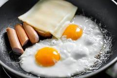 Cozimento do café da manhã/ovos Imagens de Stock