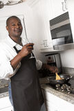 Cozimento do cozinheiro chefe da família Fotografia de Stock Royalty Free