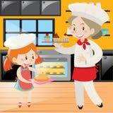 Cozimento do padeiro e da menina na cozinha Fotografia de Stock