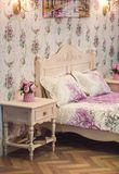 Coziness comfort interior, girl bedroom concept, with bed and with bedside table at home royalty free stock photography