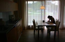 Cozinha com menina Fotos de Stock