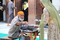 A cozinha livre a maior do mundo de Harmandir Sahib (templo dourado) Imagem de Stock