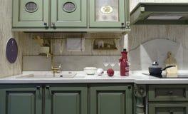 Cozinha na cor verde, cutelaria Imagem de Stock Royalty Free