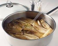 Cozinhando a chicória Foto de Stock Royalty Free