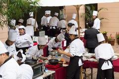 Cozinhando a escola da competição de estudantes da gestão empresarial (cozinheiro chefe júnior do ferro) Imagem de Stock