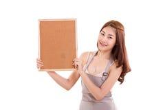 Cozinhando a mão da mulher que guarda o quadro indicador Fotos de Stock