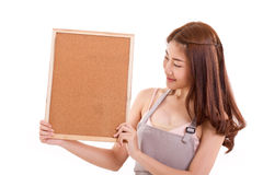 Cozinhando a mulher no avental, mão que guarda o quadro indicador Imagem de Stock