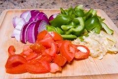 Cozinhando o prato Fotos de Stock Royalty Free