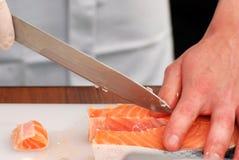 Cozinhando peixes. Imagens de Stock