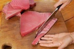 Cozinhando peixes de atum Imagem de Stock