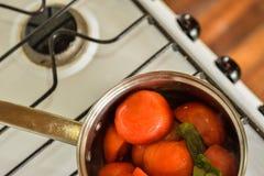 Cozinhando tomates fotografia de stock