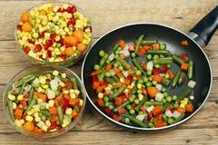 Cozinhando vegetais Imagem de Stock