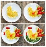 Cozinhar a salada deu forma ao símbolo do galo ou do galo do ano novo 2017 Fotos de Stock Royalty Free