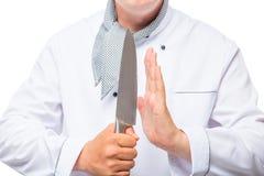 Cozinhe e uma faca afiada em suas mãos Imagem de Stock Royalty Free