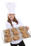 Cozinheiro chefe bonito da mulher com bolinhos Imagem de Stock