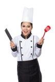 Cozinheiro chefe bonito da mulher na ação Fotos de Stock Royalty Free