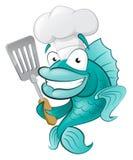 Cozinheiro chefe bonito Fish com espátula. Fotos de Stock