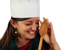Cozinheiro chefe bonito que tem o divertimento Fotos de Stock