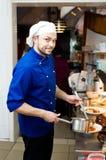 Cozinheiro chefe com colher Fotos de Stock Royalty Free