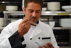 Cozinheiro chefe com fome Fotos de Stock