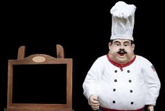 Cozinheiro chefe com placa preta para o menu Imagens de Stock