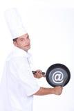 Cozinheiro chefe com @ um sinal Imagens de Stock
