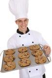 Cozinheiro chefe considerável do homem com bolinhos Fotos de Stock Royalty Free