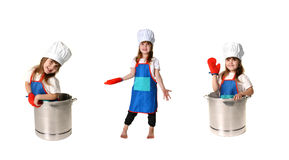 Cozinheiro chefe da criança a em três exemplares fotografia de stock royalty free