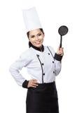 Cozinheiro chefe da jovem mulher na ação Fotografia de Stock Royalty Free