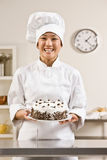 Cozinheiro chefe da padaria em brancos do toque e dos cozinheiros chefe imagem de stock